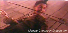 Maggie Cheung arrow in teeth