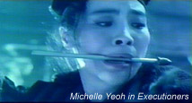 Michelle Yeoh arrow in teeth